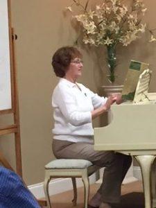 Woman playing piano.