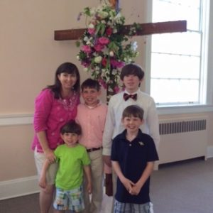 Mother and children front of sanctuary Easter Cross