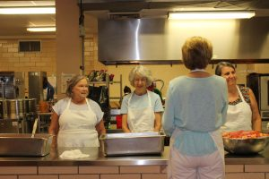 Church members on the Meals on Wheels food preparation line.