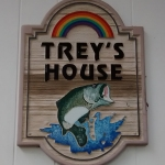 Painted wooden sign reading Trey's House.